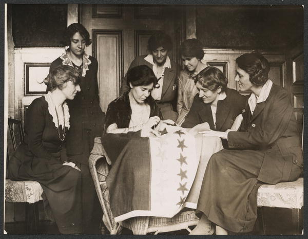 Alice Paul sews the last flag on to the 19th Amendment ratification banner