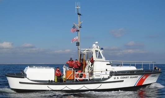 US Coast Guard Cutter with flags on the mast
